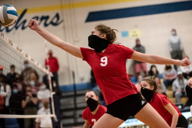 St. Philip junior Brooke Dzwik (9) attacks the ball during the Division 4 regional final on Thursday, Nov. 12, 2020 at Climax-Scotts Jr./Sr. High School in Climax, Mich.
