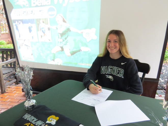 Wardlaw-Hartridge's Bella Wysocki signs her National Letter of Intent to play soccer at Wagner College.
