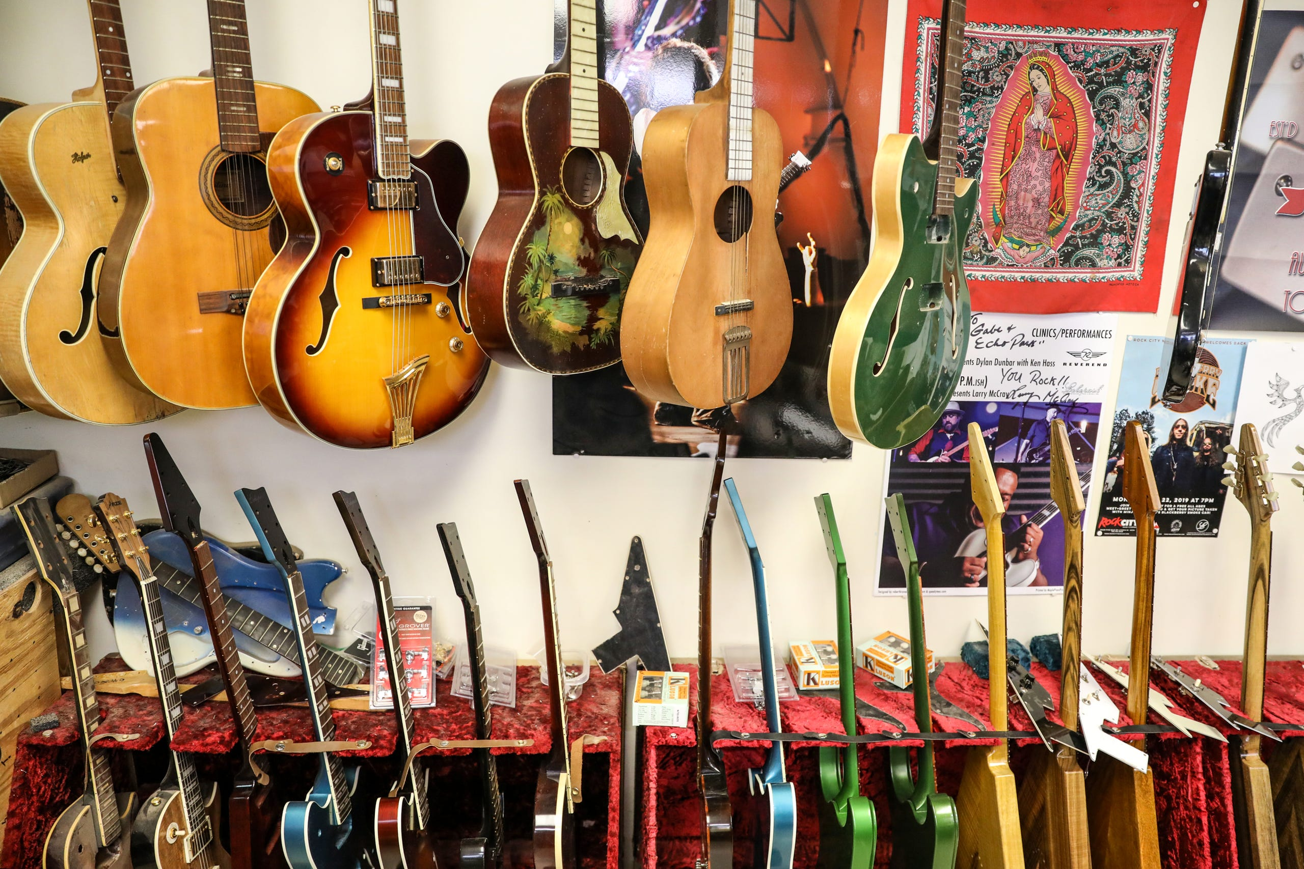 """Gabriel Currie, 52, of Detroit, grew up in Los Angeles but moved to Detroit in 2017 with his family to continue making hand-crafted guitars with the company he founded, Echopark Guitars, located in the Old Redford neighborhood of Detroit on Nov. 12, 2020. Currie recently donated """"The Salt of Detroit"""" electric guitar that he made from 100-year-old trees submerged in Lake Michigan to Ann Delisi of WDET radio. The electric guitar will be raffled off and features drawings of famous guitarists created by Detroit artist Sabrina Nelson."""
