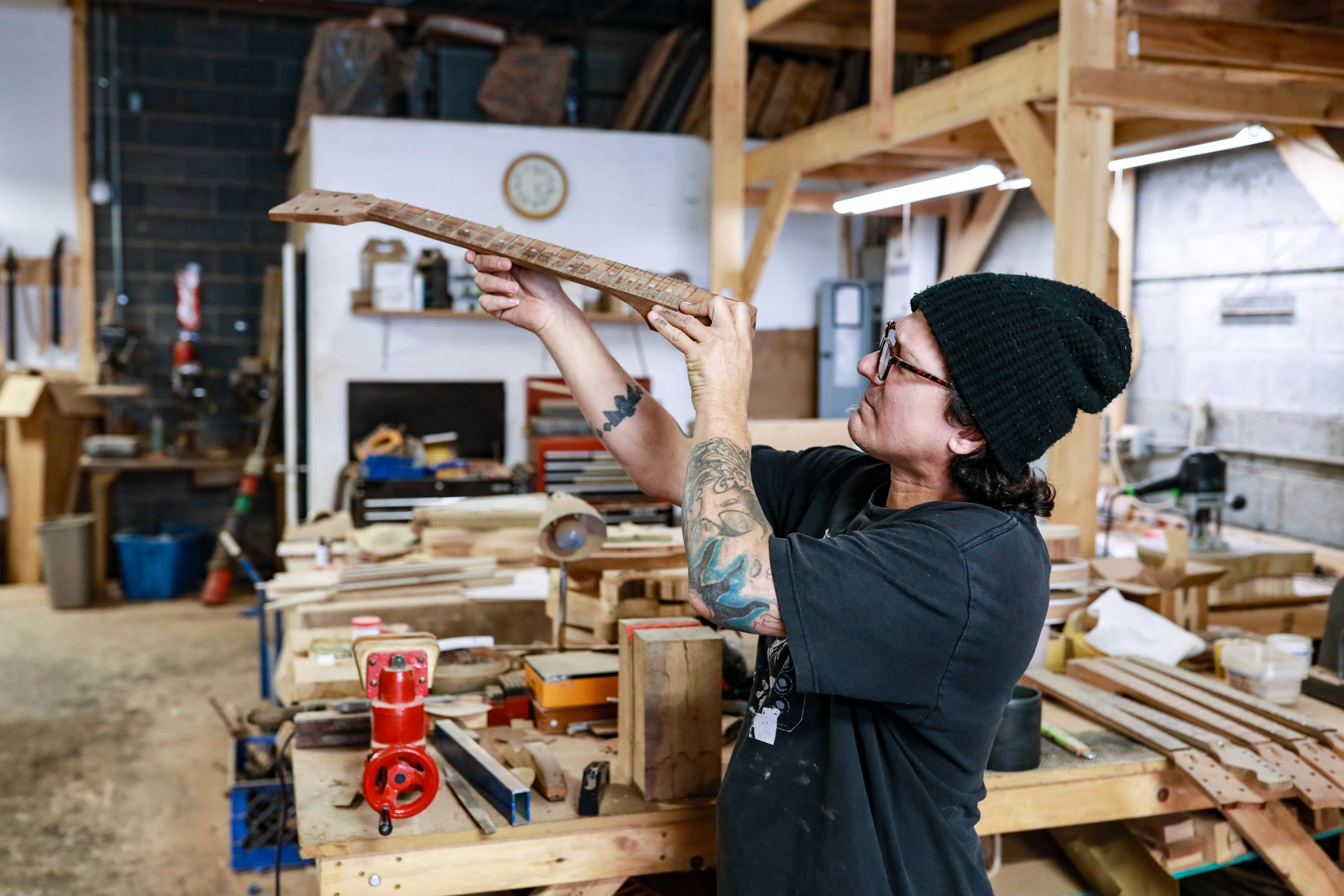 Gabriel Currie, 52, of Detroit works in his woodworking studio where he handcrafts guitars for the company he founded, Echopark Guitars, in the Old Redford neighborhood of Detroit on Nov. 12, 2020. Currie moved to Detroit in 2017 with his family from Los Angeles after finding a historic home in Detroit.
