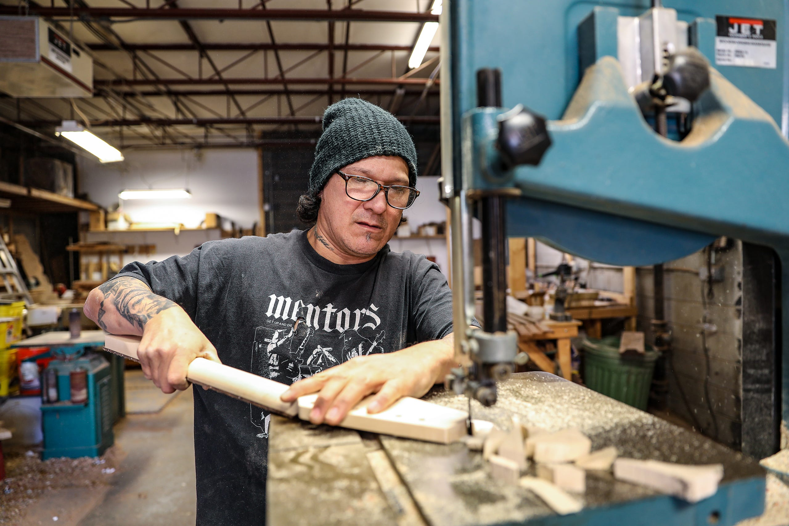 Gabriel Currie, 52, of Detroit works in his woodworking studio where he handcrafts guitars for the company he founded, Echopark Guitars, in the Old Redford neighborhood of Detroit on Nov. 12, 2020. Currie moved to Detroit in 2017 with his family from Los Angeles after finding a historic home in Detroit and to continue his craftsmanship.