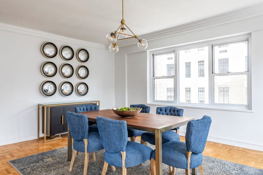 Denim chairs look polished and dressed up in this dining space.