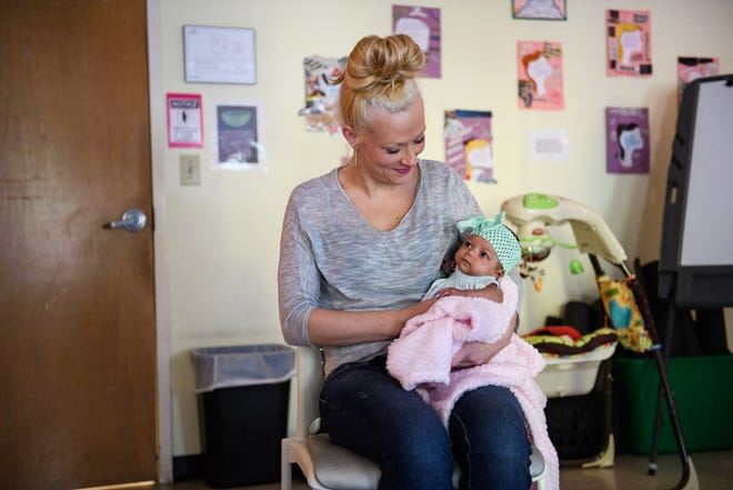Faith Godfrey holds her daughter Sophia at Serenity Place Monday, Nov. 2, 2020.