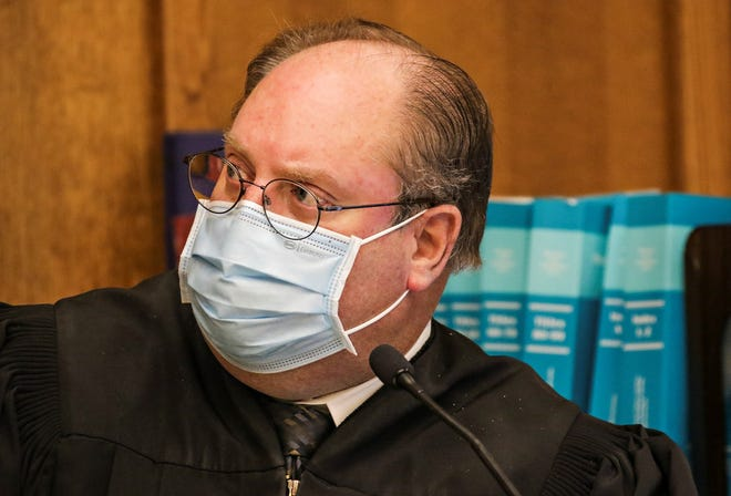 Judge Dan Wilson presides over a case brought to Flathead County District Court  by the Montana Department of Public Health and Human Services against five Flathead County businesses the department claimed where not following the state's COVID-19 directives, as seen on Nov. 12, 2020.