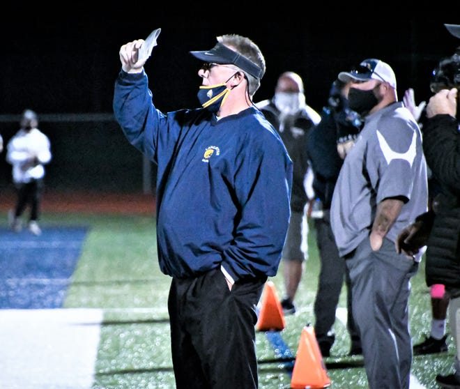 Lancaster head coach Rob Carpenter looks out on the field during the Golden Gales game against Gahanna on Oct. 16th. It was Carpenter's last home game coaching at Fulton Field. After 23 seasons as Lancaster's head coach, Carpenter announced his retirement Thursday night.