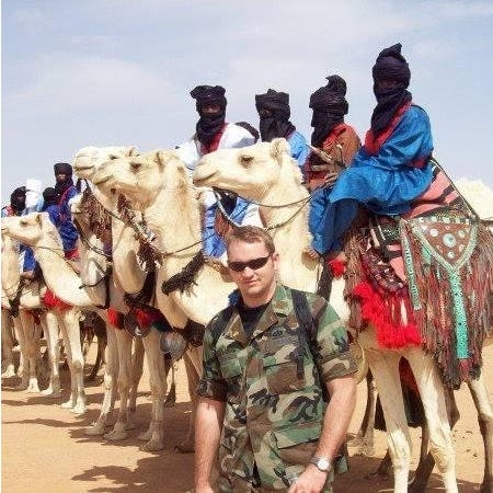 Mansfield native Jon Estridge visited northern Mali on a diplomatic trip in 2009 as part of his government job. Pictured in the background are members of the Tuareg tribe.