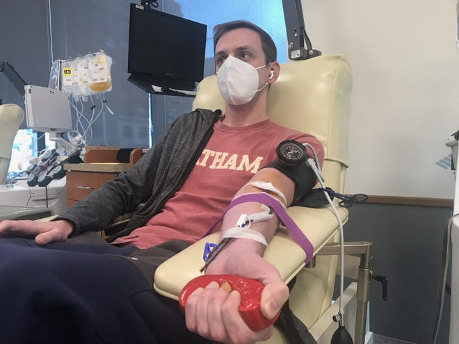 Michael Thelen, 30, donates convalescent plasma at the Versiti Blood Center of Wisconsin on Friday. It's his fourth time donating plasma since recovering from the coronavirus.