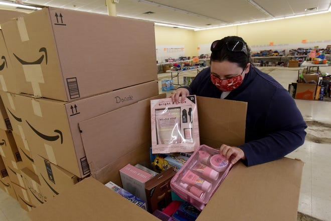Salvation Army Lt. Kaitlyn Haddix looks through a box of donated toys and personal care items for their annual Christmas gift drive. The Salvation Army supports families throughout Licking County through their Angel Tree, Adopt a Family, and other programs to help around the holidays.