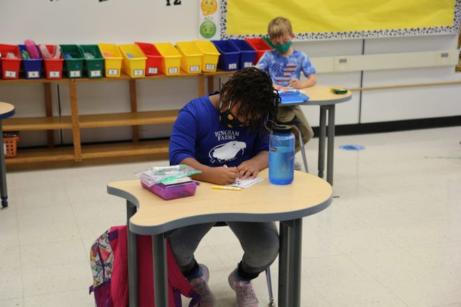 Students are masked and socially distanced in their classroom at Bingham Farms Elementary, but will be fully remote learners again effective Nov. 16, 2020 after the Birmingham district determined the number of COVID-19 cases is too high to continue in-person learning.