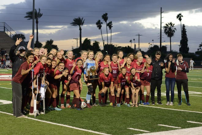 The Northland Prep Spartans pose after winning the girls 2A soccer state championship in Scottsdale, Ariz. on Saturday, Nov. 7, 2020.
