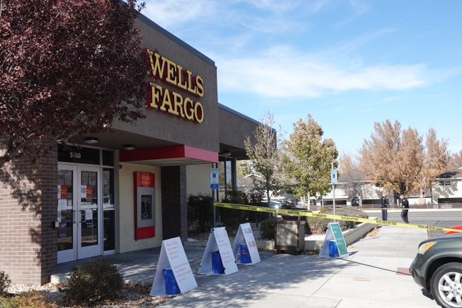 Police close Wells Fargo after a person was shot in the parking lot at the Neil Lane location in Reno Nov. 12, 2020.