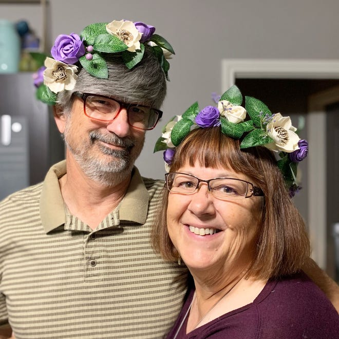 Sheri and Gilbert Honea show off handmade wooden flowers from Blessed with Grace designs.