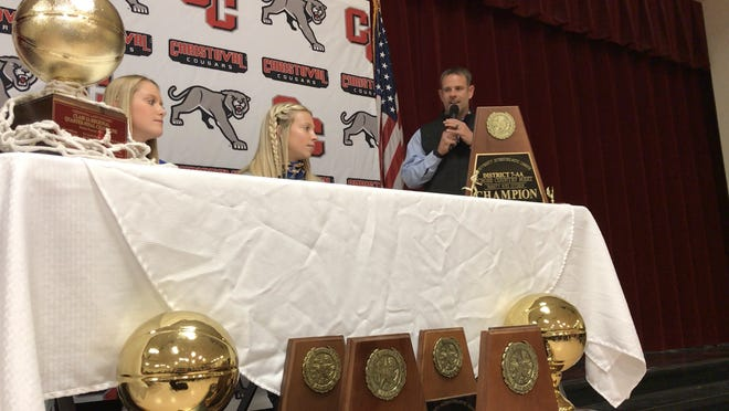 Christoval High School head girls basketball coach and athletic director Scott Richardson, right, talks about Christoval athletes Graci Jones, left, and Allison Vaughn, middle, during a national letter of intent signing ceremony Friday, Nov. 13, 2020, in the Christoval cafeteria.