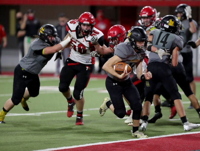Wolsey-Wessington's Corbin Haarmeyer runs into the end zone to score during Thursday's Class 9B Championship game against Dell Rapids St. Mary at the Dakotadome in Vermillion. American News photo by John Davis taken 11/12/2020