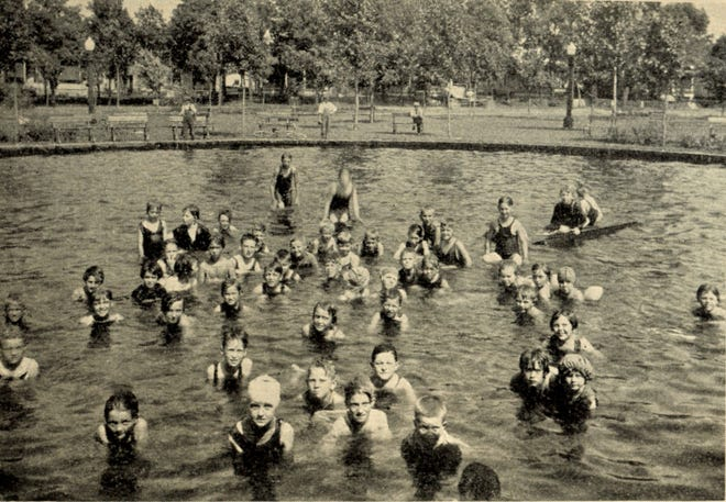 The image is from 1937 and shows the wading pool just north of the firehouse, looking southeast.