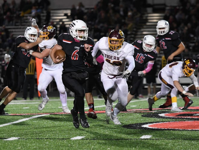Brandon Valley quarterback, Joe Kolbeck, finds a gap in the Class AAA match up against Harrisburg on Friday night.