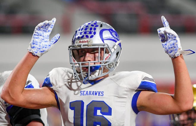 Bridgewater/Emery/Ethan tight end Eric Gustafson signals that their team scored a touchdown in the class 11B state football championship on Friday, November 13, at the DakotaDome in Vermillion.
