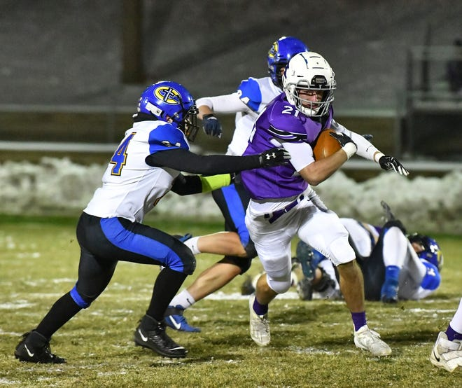 Albany's Nolan Rueter carries the ball during the game Thursday, Nov. 12, 2020, at Michael Field in Albany.