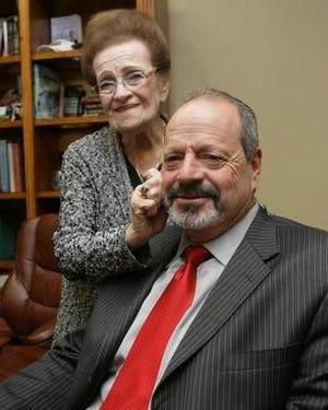 Rhoberta Leeser stands by her son, Oscar Leeser, in this Dec. 24, 2010, file photo.