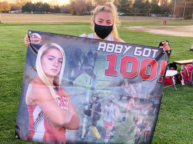 Delsea senior captain Abby Hartwell celebrates scoring her 100th career field hockey goal.