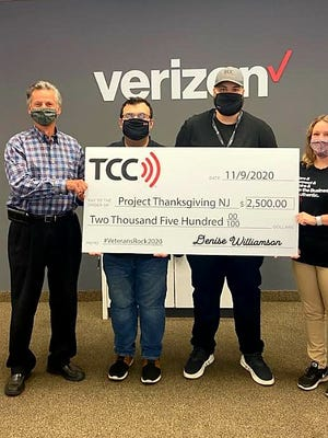 Alex Kaganzev (from left) accepts a $2,500 check from Brandon Cruz, Moustafa Hassan, Brittany Dilks on behalf of Project Thanksgiving. The check represents a grant from Verizon TCC, which will be used to assist South Jersey veterans and their families.