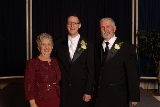 Dustin Coleman of Smyrna, Delaware with his father Ronald and late step-mother Carla.