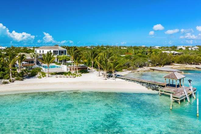 Turks and Caicos Islands: The six-bedroom Cabuya Villa sits on a beachfront a private boat dock, poo, gym and and butler service.