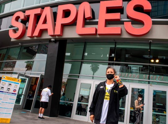 Civic leader and co-founder of the Black Lives Matter Los Angeles chapter, Melina Abdullah, poses for a photo after voting at the Staples Center early on November 3.