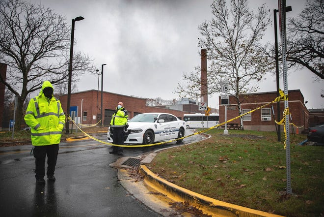 Veterans Affairs Police guard the entrance to a maintenance facility where two workers died and a third person is missing after an apparent steam explosion in a maintenance building at a Veterans Affairs hospital in West Haven, Conn., Friday, Nov. 13, 2020.