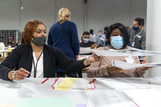 Gwinnett county workers begin their recount of the ballots on Nov. 13, 2020 in Lawrenceville, Georgia.