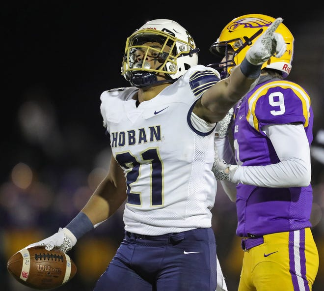Hoban running back Victor Dawson signals a first down after rushing for a large gain against Avon during the first half of a Division II state semifinal football game at Byers Field, Friday, Nov. 13, 2020, in Parma, Ohio. [Jeff Lange/Beacon Journal]