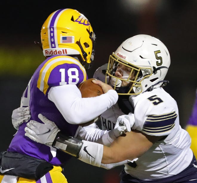 Hoban linebacker Damon Ollison II, right, brings down Avon quarterback Niko Pappas during the second half of a Division II state semifinal football game at Byers Field, Friday, Nov. 13, 2020, in Parma, Ohio. [Jeff Lange/Beacon Journal]