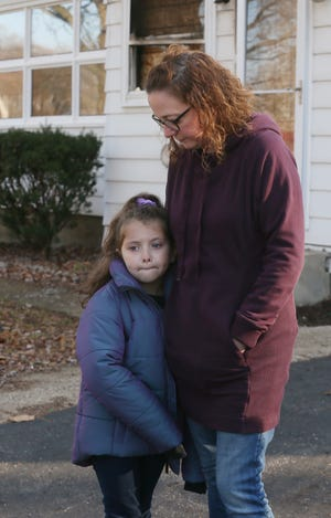Natalie Weisler, 7, with mom Megan Weisler, tells Saturday how she woke up her family to save them from a fire at their New Franklin home.