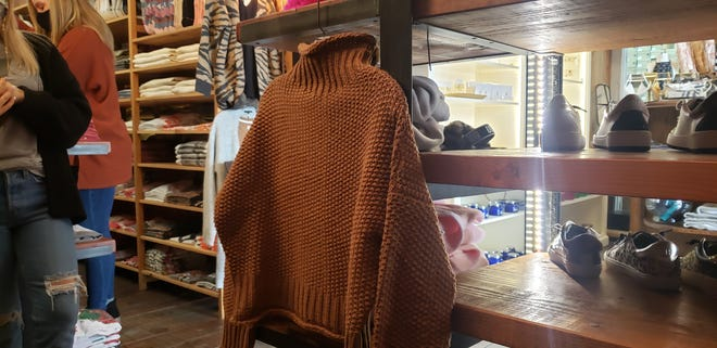 Cropped sweaters, such as this one at The Rage, are on trend for winter.