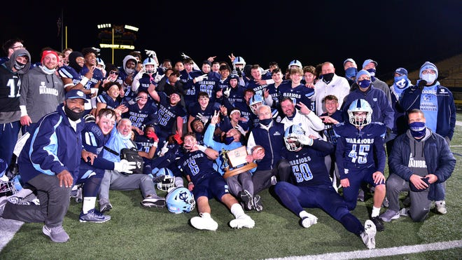The Central Valley High School football team and coaches pose with the championship trophy after winning the 2020 WPIAL Class 3A championship over Elizabeth Forward at North Allegheny High School.