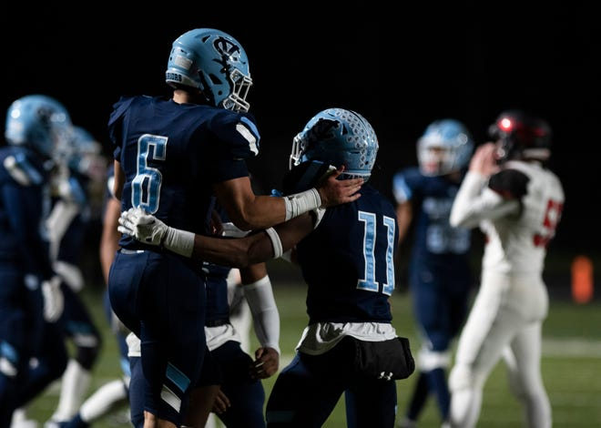 Central Valley's Amarian Saunders (11) and Matt Merritt (6) celebrate a defensive stop against Elizabeth Forward during the WPIAL Class 3A football championship at North Allegheny High School.