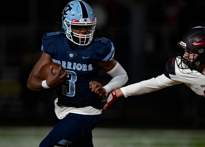 Central Valley QB Ameer Dudley runs out of the reach of an Elizabeth Forward defender during the WPIAL Class 3A football championship at North Allegheny High School.