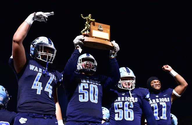 Central Valley's Justin Thompson (44), Sean FitzSimmons (50), Cody Presto (56), and Amarian Saunders (11)  celebrate their WPIAL Class 3A championship shutout win over Elizabeth Forward Friday at North Allegheny High School.