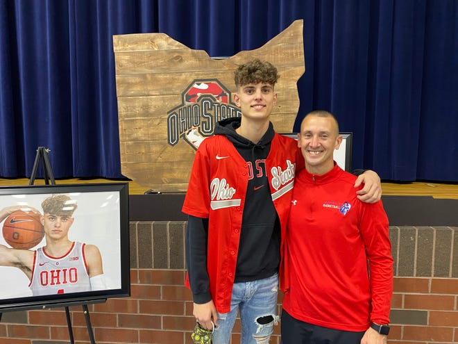 Kalen Etzler, left, and coach and uncle Doug Etzler smile after the younger Etzler officially signed to play for Ohio State in a press conference at Convoy (Ohio) Crestview High School on November 11, 2020.
