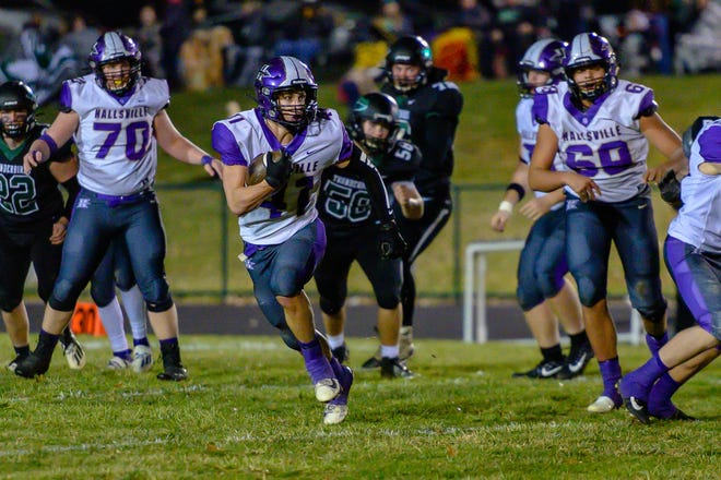 Hallsville's Harrison Fowler (41) breaks to the outside avoiding the North Callaway defense during the Class 2 District 5 championship game last season at North Callaway High School.