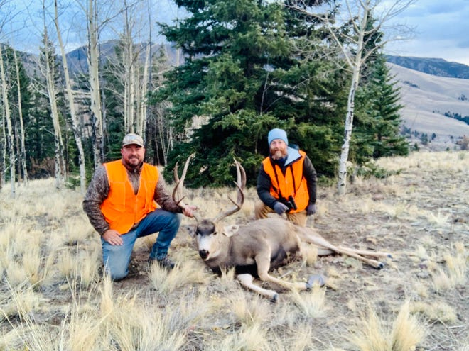 Lifelong friends Brandon Butler and Jeremy James are all smiles with Brandon's Colorado mule deer.
