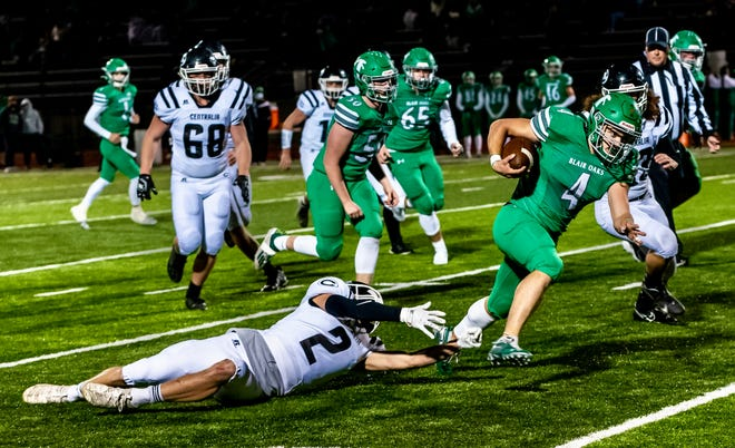 Blair Oaks' Jayden Purdy (4) runs the ball while avoiding the outstretched arms of Centralia's Liam Hill (2) during the Class 3 District 4 championship game Friday night at Blair Oaks High School.