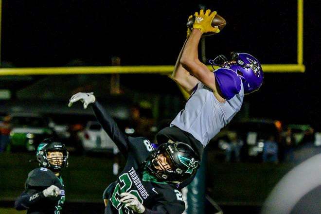 Hallsville's AJ Austene (7) goes up and makes a catch above North Callaway's Layne Wortman (28) during the Class 2 District 5 championship game Friday night at North Callaway High School.