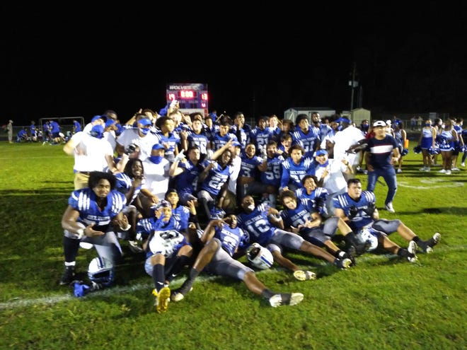 The Deltona High football team celebrates its 19-13 victory over Tampa Freedom on Friday night in Deltona. The Wolves won their first playoff game. Nov. 13, 2020.