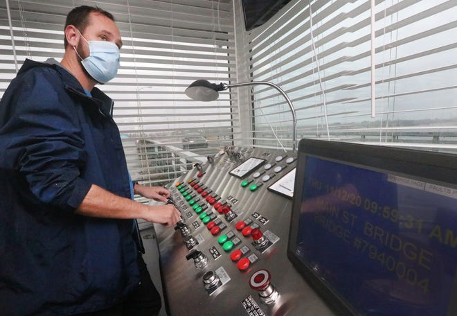 Dustin Stock, working the controls at the Main Street Bridge.