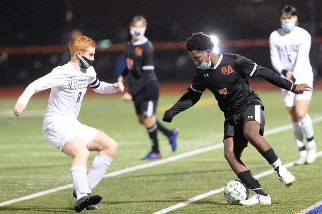 Oliver Ames' Kevin Louhis, right, dribbles around Mansfield's Tom Lanzillo, during their game on Friday, Nov.13, 2020.