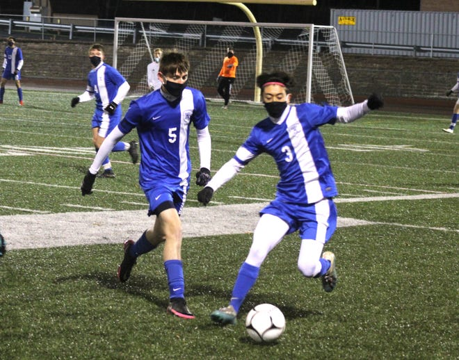 Alfred-Almond seniors Carsen Hann (5) and Aquila Cushing (3) converge on the ball Friday night in Bolivar.