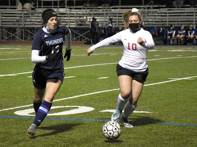 Central Valley Academy's Carissa Roux and Vernon-Verona-Sherrill's Madison Ward (from left) pursue the ball near then middle of the field during the second half of the Tri-Valley League's Pioneer Division girls soccer championship match Friday in Ilion.