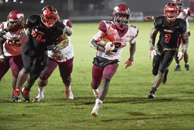 Raines receiver Kareem Burke (2) runs into the end zone for a first-half touchdown against Westside.