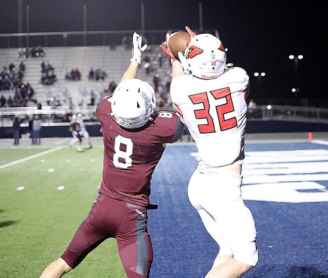 Pottsboro's Titus Lyons catches a touchdown pass over  White Oak's Jackson frazier in a 3A Division I Region II bi-district game at Paris.